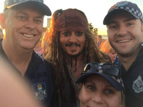 Just Johnny Depp in full Jack Sparrow costume sharing a selfie with Australian police