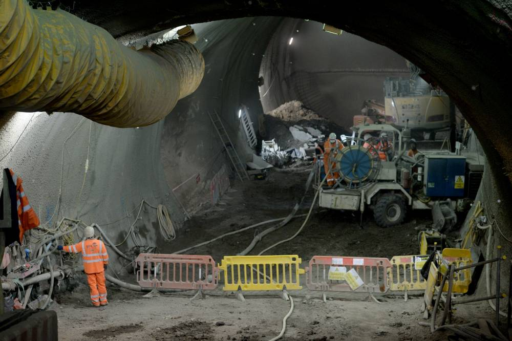 Embargoed to 0001 Thursday June 4 Construction work at the escalator slope for the Bond Street Crossrail site, London. PRESS ASSOCIATION Photo. Picture date: Wednesday June 3, 2015. A major milestone in the £14.8 billion cross-London Crossrail has been reached with the completion of the tunnelling work. Eight giant boring machines have been cutting their way through earth under central London to pave the way for the start of services in 2018, with full services in 2019. The 26 miles of London tunnelling has now finished on the project which will see trains running from as far west as Reading in Berkshire to as far east as Shenfield in Essex. Ten new Crossrail stations are being constructed in central London and in London Docklands, as well as one at Abbey Wood in south London. The Abbey Wood link is one of the two spurs, with another running to Heathrow Airport in west London. Photo credit should read: Anthony Devlin/PA Wire