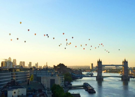 Hot air balloons float over Tower Bridge, and the London skyline at 5am this morning June 7, 2015.  See SWNS story SWBALLOON.  Fifty hot air balloons  lifted off from Shoreditch Park and filled the blue sky over London to raise cash for good causes through the Lord Mayor's Appeal.  The early-morning stunt - the first of its kind in more than two decades - was aimed at making more people aware of the charity, linked to the Lord Mayor of the City of London, which is supporting Scope and Mencap.