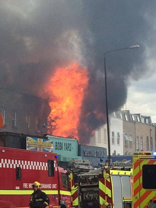 15 Jun 2015, London, England, UK --- 15th June 2015 -- Ravaging flames engulf a house on Hackney Road, London. Picture courtesy of Mark Wake on Twitter. -- Police cordon off traffic and access to the streets Hackney Road as firefighters battle a massive fire on Yorkton Street in Hackney. There are no reports of casualties. --- Image by © Demotix Live News/Demotix/Corbis