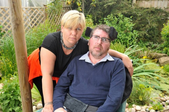 **STRICT ONLINE EMARGO UNTIL 00.01 TUESDAY 23RD JUNE 2015*** PIC FROM CATERS NEWS - (PICTURED: Tracy and Nick Gaskin from Quorn. Nick has MS and is confined to wheelchair  he can neither walk nor talk but has been told he has to go for a Job Centre interview to make sure he still qualifies for disability allowance.) - A shocked and disgusted wife has blasted Jobcentre officials who ordered her husband to attend a Jobcentre interview  despite the fact he cannot walk, talk or feed himself. Nick Gaskin, 46 of Quorn, Leicestershire, was diagnosed with primary progressive multiple sclerosis 16 years ago and communicates by blinking. He is unable to do anything from himself and requires round-the-clock care from wife Tracy, 41. However, Tracy was stunned to receive a letter from the Loughborough Jobcentre on Wednesday of last week telling Nick he needed to attend a work-focussed interview for Employment and Support Allowance. SEE CATERS COPY.
