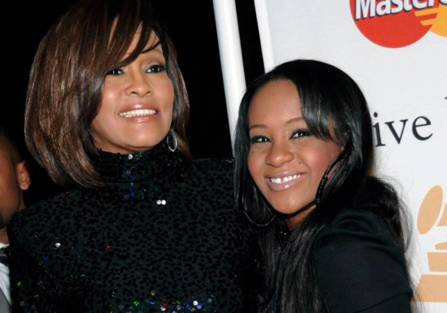 FILE - In this Feb. 12, 2011, file photo, singer Whitney Houston, left, and daughter Bobbi Kristina Brown arrive at an event in Beverly Hills, Calif. Brown is moving to hospice care after months of receiving medical care. Pat Houston says in a statement Wednesday, June 24, 2015, that Whitney Houstonís daughterís ìcondition has continued to deteriorate. Brown was found face-down and unresponsive in a bathtub of her Georgia home earlier this year. She underwent surgery to replace her breathing tube with a tracheostomy tube in February.  (AP Photo/Dan Steinberg, File)