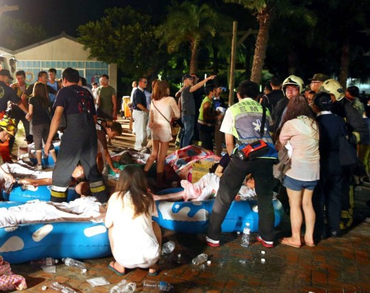 Mandatory Credit: Photo by Xinhua/REX Shutterstock (4885281e)  People gather on the open ground after a fire took place at a park in New Taipei  Formosa Water Park fire, Taipei, Taiwan - 27 Jun 2015  A fire, which was suspected of resulting from an explosion of a large amount of unknown flammable powder, in a recreational park in Taiwan's New Taipei city has injured at least 474 people.