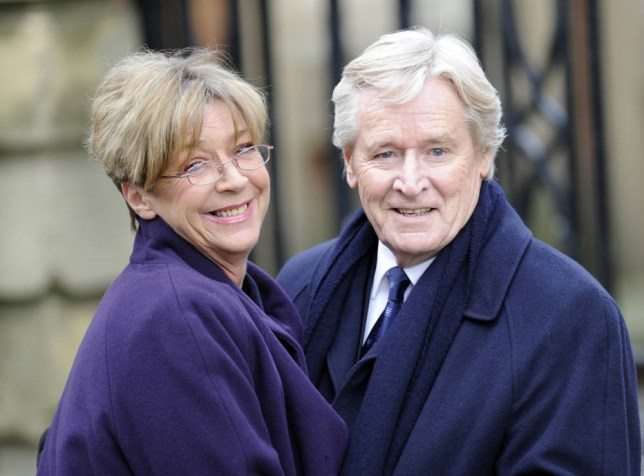 Mandatory Credit: Photo by McPix Ltd/REX Shutterstock (2133917q).. Anne Kirkbride and William Roache.. Coronation Street on Location filming, Manchester, Britain - 10 Feb 2013.. Anne Kirkbride and Bill Roache look as loved up as their Coronation Street characters Deirdre and Ken as they share a kiss while filming on location...