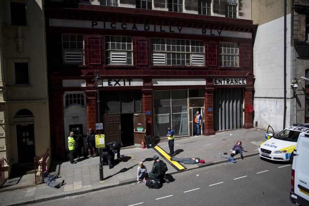 People take part in a training exercise for London's emergency services outside the disused Aldwych underground train station in London, Tuesday, June 30, 2015. Hundreds of British police are taking part in a major counter-terror exercise in London, testing the abilities of emergency services to respond to a Tunisia-style attack of extremists with firearms. The exercise dubbed Operation Strong Tower has been planned for six months and is not connected to the recent attack at a north African beach resort.  (AP Photo/Matt Dunham)
