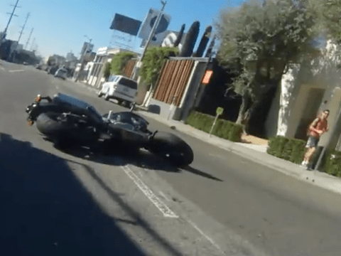Motorcyclist tells driver to stop texting, driver responds by knocking him off his bike