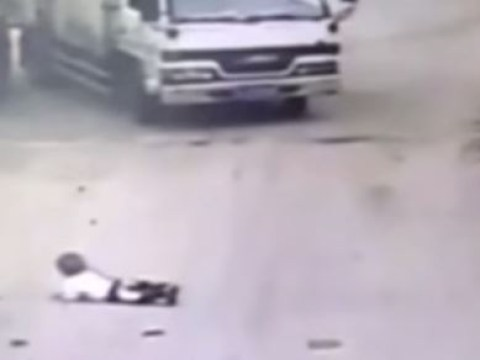 Toddler makes miraculous escape after lorry reverses over him in the street