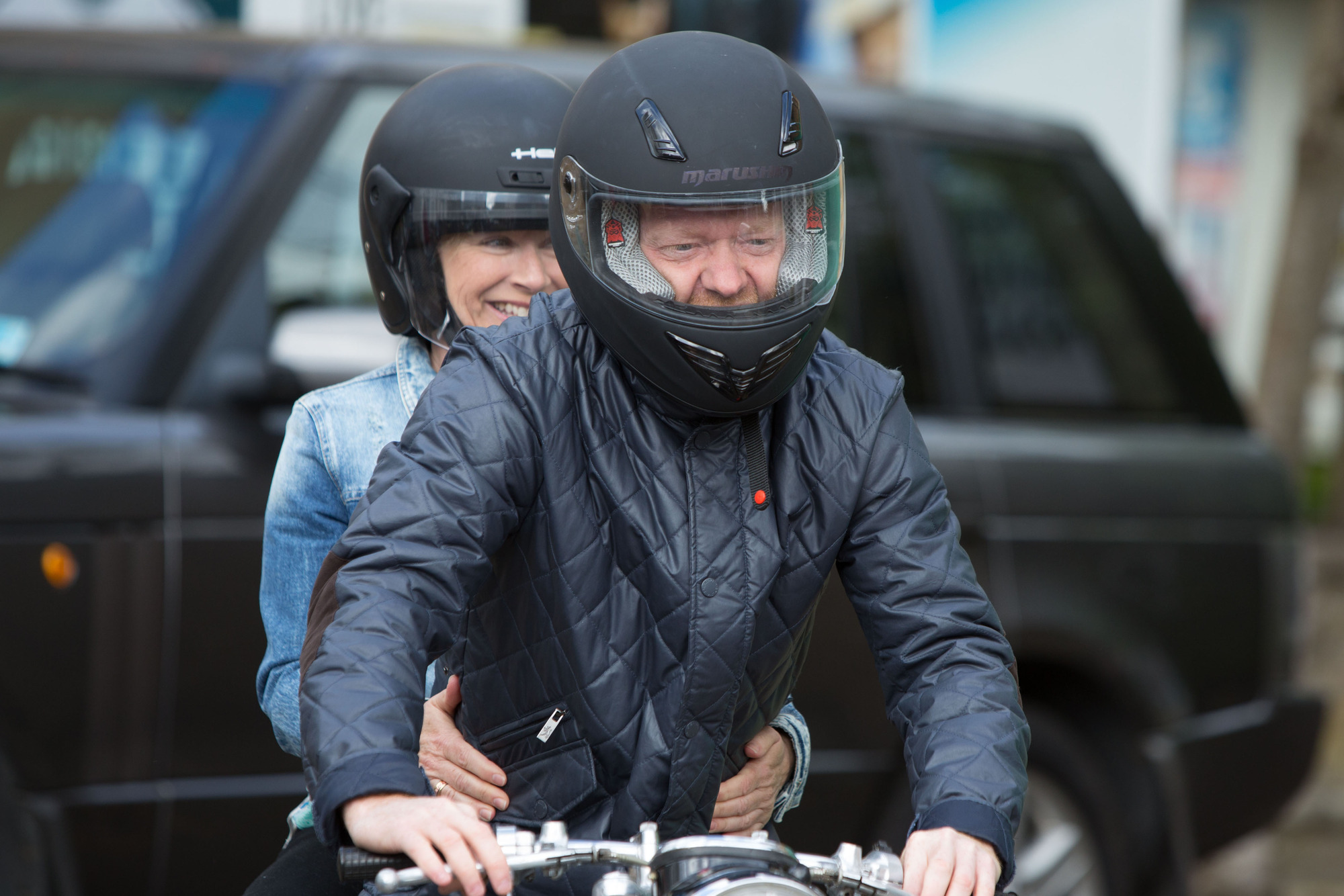 WARNING: Embargoed for publication until 30/06/2015 - Programme Name: EastEnders - TX: 06/07/2015 - Episode: 5097 (No. n/a) - Picture Shows: Carol and Max prepare to go for a spin on Jim's old bike.  Carol Jackson (LINDSEY COULSON), Max Branning (JAKE WOOD) - (C) BBC - Photographer: Jack Barnes