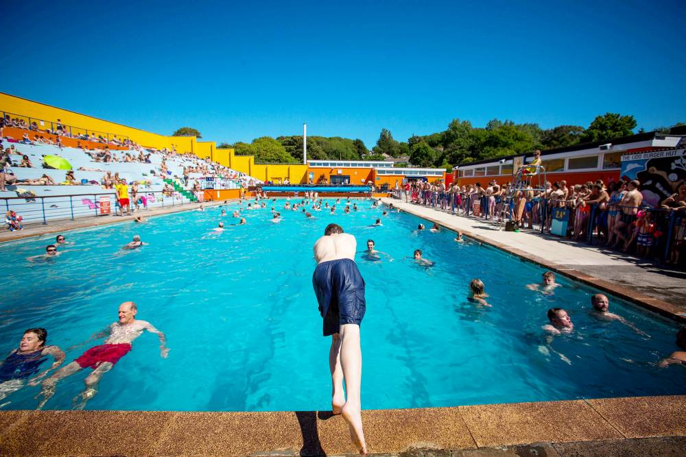 People flock to Portishead Open Air Pool to take a dip and cool off on the hottest day of the year so far.