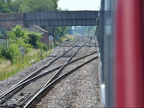 Boy dies and two teens injured after climbing on to train