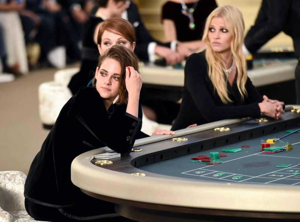 Mandatory Credit: Photo by David Fisher/REX Shutterstock (4897566at).. Kristen Stewart, Julianne Moore and Lara Stone playing roulette on the catwalk.. Chanel show, Autumn Winter 2015, Haute Couture, Paris Fashion Week, France - 07 Jul 2015.. ..