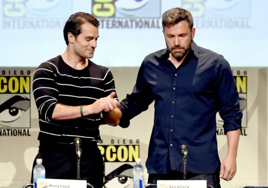 """SAN DIEGO, CA - JULY 11:  Actors Henry Cavill (L) and Ben Affleck from """"Batman v. Superman: Dawn of Justice"""" attend the Warner Bros. presentation during Comic-Con International 2015 at the San Diego Convention Center on July 11, 2015 in San Diego, California.  (Photo by Kevin Winter/Getty Images)"""