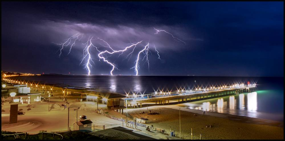 BNPS.co.uk (01202 558833) Pic: KevinFerrioli/BNPS Stunning lightning storm of the coast near Bournmouth last night. Photographer Kevin Ferrioli captured the dramatic scene from Boscombe pier.