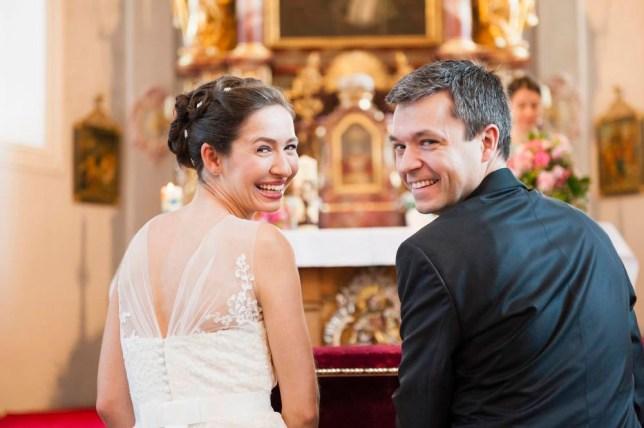Rear view of bride and bridegroom at church altar