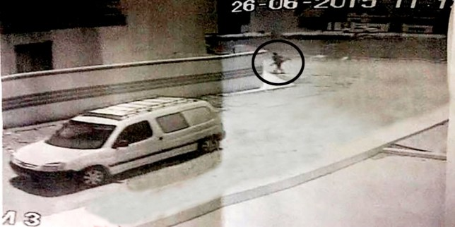 This is the moment Tunisian gunman Rezgui was dropped off by an accomplice 300 yards from the beach massacre.Rezgui can be seen leaving the quiet side street after being dropped off in a white Peugeot Partner van 40 minutes before his murderous rampage in Sousse on June 26.nThe gunman can be seen at the top of the image carrying the parasol in which he had hidden the Kalashnikov rifle he used to kill 38 holidaymakers, including 30 Britons and three Irish tourists.nPolice are still hunting for the car, which they believe is key in establishing Rezgui's movements in the days before the attack and the people who helped him.n***INTERNET IMAGE TAKEN FROM LOCAL WEBSITE alikhbariaattounisia.com***