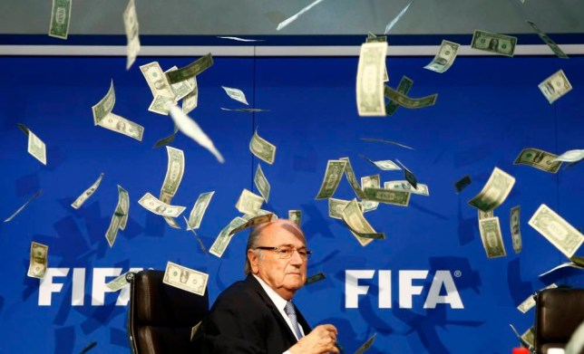 BrItish comedian known as Lee Nelson (unseen) throws banknotes at FIFA President Sepp Blatter as he arrives for a news conference after the Extraordinary FIFA Executive Committee Meeting at the FIFA headquarters in Zurich, Switzerland July 20, 2015. World football's troubled governing body FIFA will vote for a new president, to replace Sepp Blatter, at a special congress to be held on February 26 in Zurich, the organisation said on Monday. REUTERS/Arnd Wiegmann