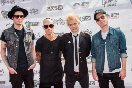 22 Jul 2015, Cleveland, Ohio, USA --- Deryck Whibley, Cone McCaslin, Tom Thacker, and Frank Zummo of Sum 41 attends the 2015 Alternative Press Music Awards at Quicken Loans Arena in Cleveland, Ohio. --- Image by © Amy Harris/Corbis