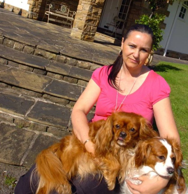 08/04/2011 File picture of Lesley Brogan, aged 42, is pictured with her Cavalier King Charles dogs outside her home.  Lotto winner Lesley Brogan claimed £100,000 in false benefits for her husband has been jailed for nearly two years.