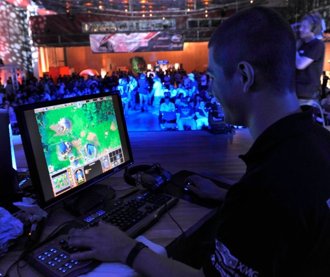 FILE - In this Aug. 7, 2009, file photo, a participant plays a computer game during the Intel Friday Night Game, a competition of the ESL, Electronic Sports League, in Dresden, Germany. The Electronic Sports League says it will begin randomly drug testing players at its competitive video game events. The e-sports organization announced plans Thursday, July 23, 2015, to work with the World Anti-Doping Agency to create and enforce rules surrounding the use of performance-enhancing drugs. (AP Photo/Matthias Rietschel, File)