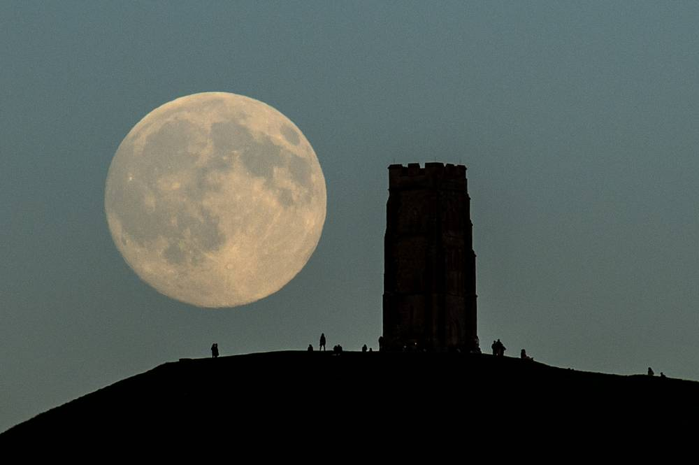Moonlovers witnessing the blue moon on Glastonbury Tor (Picture: Ben Birchall/PA Wire)