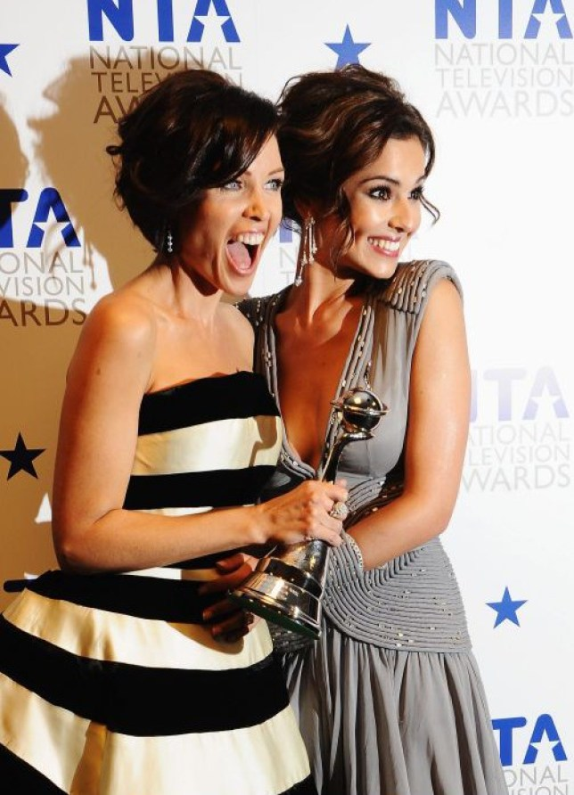 X Factor judges Danni Minogue and Cheryl Cole appear with their award for Most Popular Talent Show at the National Television Awards held at O2 Arena on January 20, 2010 in London, England.  (Photo by Ian Gavan/Getty Images)