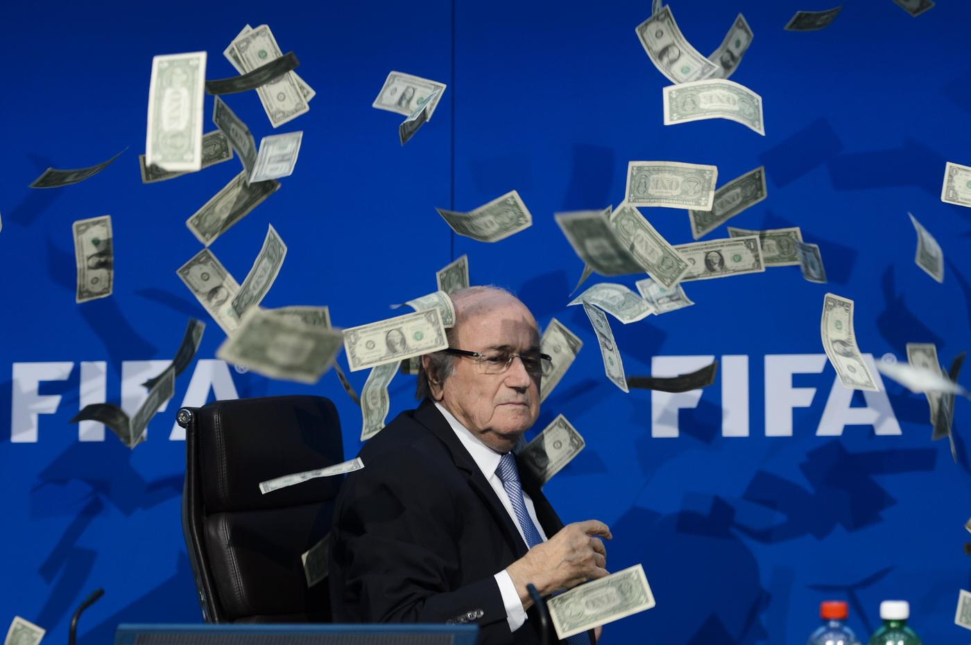 Lee Nelson showers Sepp Blatter with cash after gatecrashing Fifa press conference