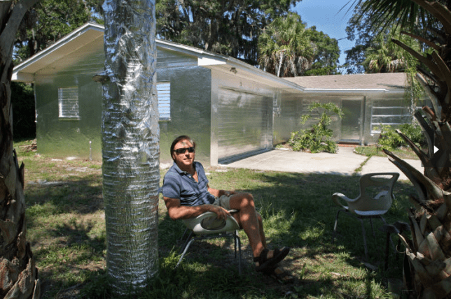 Piotr Janowski covered his house in tin foil for an art project (Picture: AP)