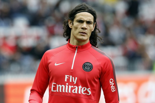 Paris Saint-Germain's Uruguayan forward Edinson Cavani takes part in a training session prior to the French L1 football match between Nice and Paris Saint Germain on April 18, 2015 at the Allianz Riviera stadium in Nice, southeastern France. AFP PHOTO / VALERY HACHE        (Photo credit should read VALERY HACHE/AFP/Getty Images)