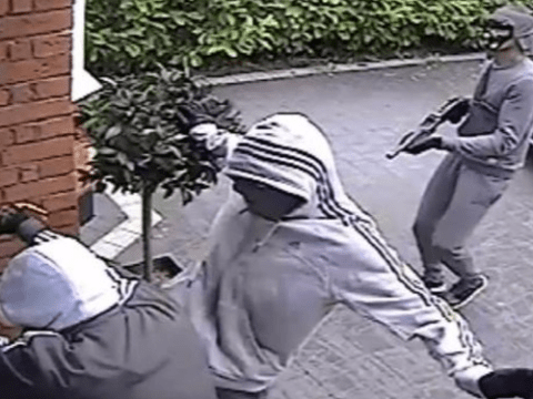 Police hunt gang caught on CCTV breaking into home armed with shotgun