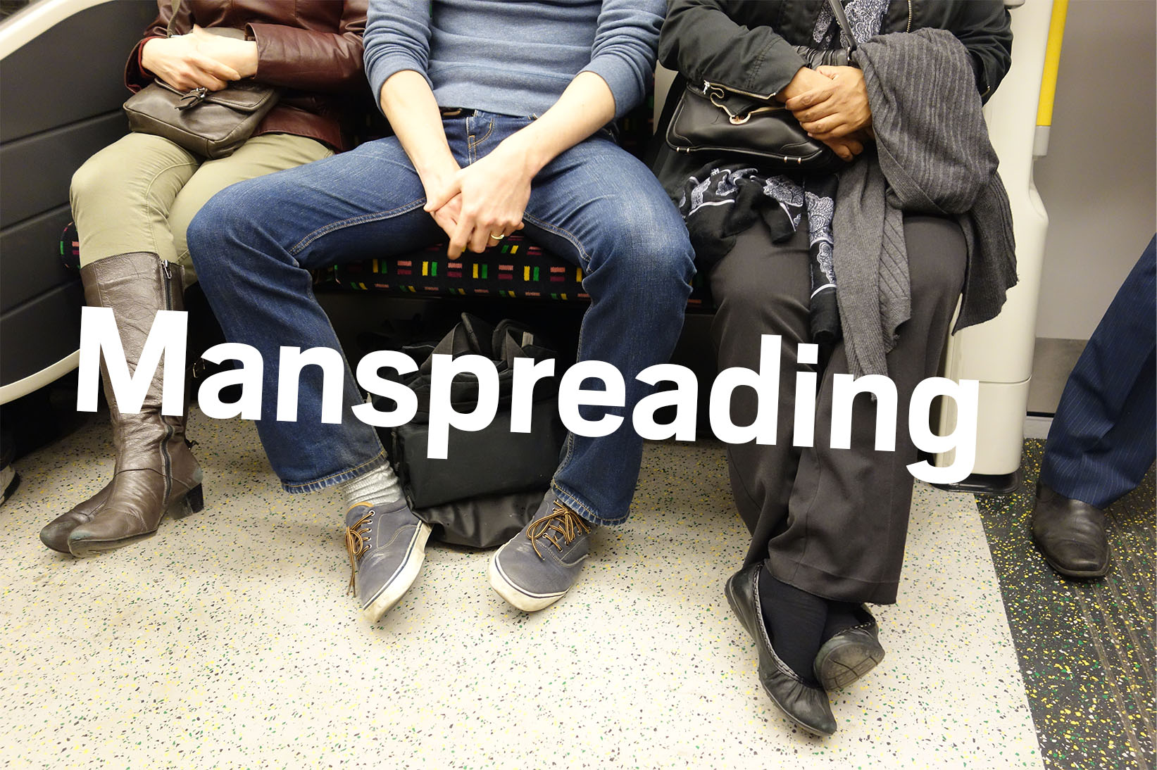 manspreading on the tube nevermindtheend/Flickr