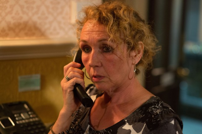 WARNING: Embargoed for publication until 00:00:01 on 30/08/2015 - Programme Name: EastEnders - TX: 11/09/2015 - Episode: 5136 (No. n/a) - Picture Shows: Desperate to send a message to Phil, Kathy turns to someone she can trust and calls The Vic to speak to Tracey. Stunned, Tracey struggles to come to terms with the revelation and tells Mick what she's heard. Outside, Tracey reaches out to Phil but will he tell Tracey the truth? Tracey (JANE SLAUGHTER) - (C) BBC - Photographer: Jack Barnes