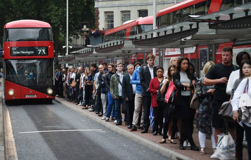 epa04873952 Commuters queue for buses during a tube strike at Victoria Station in London, Britain, 06 August 2015. Underground workers have called a 36-hour strike for the second time within a month. Millions of Londoners will have to seek alternative transport to work 06 August. EPA/ANDY RAIN