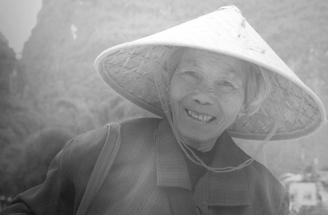 YANGSHUO, CHINA - DECEMBER 2014: Paul photographed this smiling lady in a sun hat and recreated her image with painstaking patience and precision on December, 2014 in Yangshuo, China.  AN ARTIST with an eye for detail creates hyper realistic pencil drawings which can take up to SIX WEEKS to complete. These remarkable pictures are the work of Scottish artist Paul Cadden, who uses graphite pencils to recreate photographs of people and landscapes. His latest subjects were taken on a trip to China and depict everyday life in Hong Kong and Guangzhou - a huge metropolis located in the south of the country. The busy cultural capitals of London and Barcelona also feature in Paul's work. A single drawing can take the Glasgow-based artist anywhere from two to six weeks to finish, depending on the size and complexity of the piece. PHOTOGRAPH BY Paul Cadden / Barcroft Media UK Office, London. T +44 845 370 2233 W www.barcroftmedia.com USA Office, New York City. T +1 212 796 2458 W www.barcroftusa.com Indian Office, Delhi. T +91 11 4053 2429 W www.barcroftindia.com