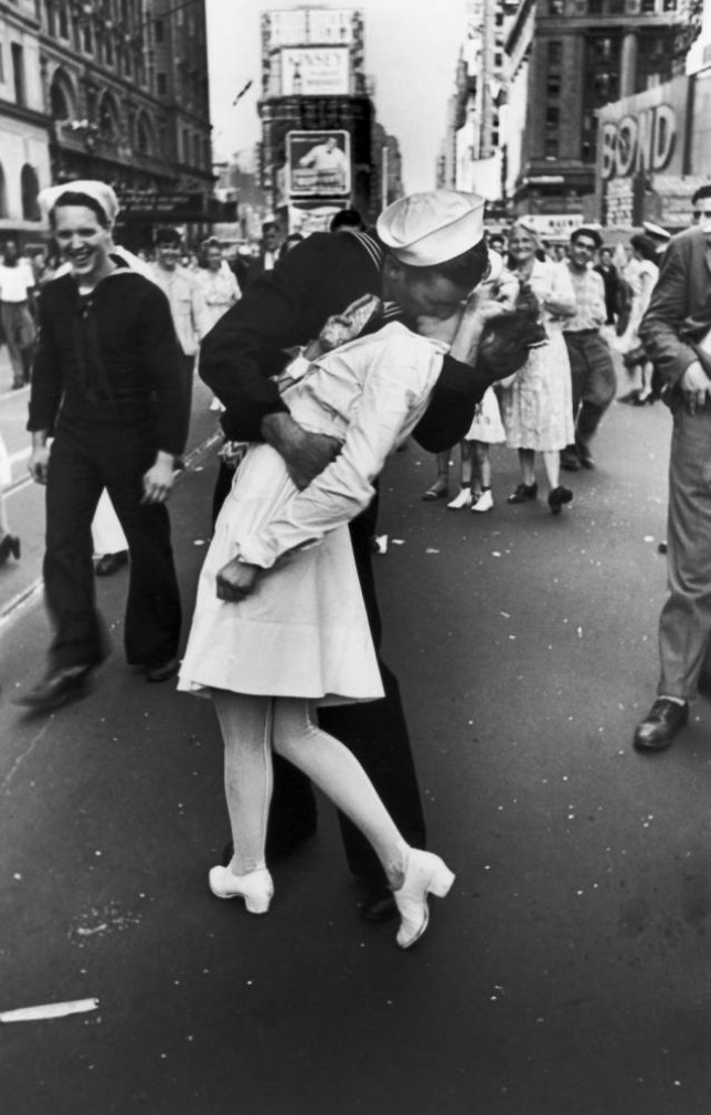 NEW YORK, UNITED STATES - AUGUST 14: A jubilant American sailor clutching a white-uniformed nurse in a back-bending, passionate kiss as he vents his joy while thousands jam Times Square to celebrate the long awaited-victory over Japan. (Photo by Alfred Eisenstaedt/Pix Inc./The LIFE Picture Collection/Getty Images)