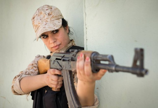 "Kurdish female Peshmerga troops of The 2nd Battalion who are fighting IS. Sgt Sazan Taib. Material must be credited ""The Sun/News Syndication"" unless otherwise agreed. 100% surcharge if not credited. Online rights need to be cleared separately. Strictly one time use only subject to agreement with News Syndication"