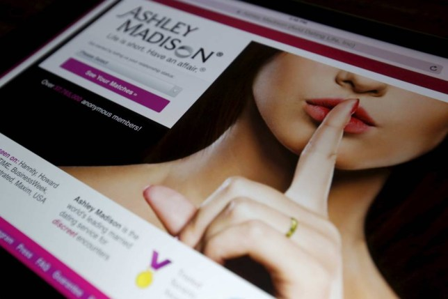 The homepage of the Ashley Madison website is displayed on an iPad, in this photo illustration taken in Ottawa, Canada in this July 21, 2015 file photo. Hackers have followed through on a threat to release online a huge cache of data, including customer information, that was stolen a month ago from cheating spouses website AshleyMadison.com, several tech websites reported on August 18, 2015. REUTERS/Chris Wattie/Files