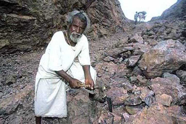Dashrath Manjhi spent 22 years chiselling this massive gap through a mountain out of love for his dead wife, who died because the 34-mile route round to the nearest town was too far to take her for urgent medical care