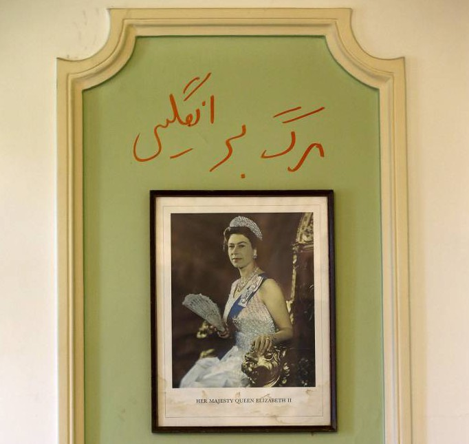 "Graffiti in Persian reading ""Death to England"" is seen above a picture of Britain's Queen Elizabeth at the British Embassy in Tehran, Iran August 23, 2015. Britain reopened its embassy in Tehran on Sunday, nearly four years after protesters ransacked the ambassador's residence and burned the Union Jack. In a signal of the most striking thaw in Western ties with Iran for over a decade, Foreign Secretary Philip Hammond watched the British flag being raised in the garden of the opulent 19th century building while the national anthem played. REUTERS/Darren Staples TPX IMAGES OF THE DAY"