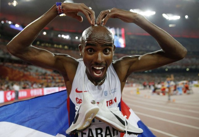 """Britain's Mo Farah does his 'mobot' celebration after winning the final of the men's 5000 metres athletics event at the 2015 IAAF World Championships at the """"Bird's Nest"""" National Stadium in Beijing on August 29, 2015. AFP PHOTO / ADRIAN DENNISADRIAN DENNIS/AFP/Getty Images"""