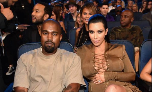 LOS ANGELES, CA - AUGUST 30: Rapper Kanye West (L) and tv personality Kim Kardashian in the audience during the 2015 MTV Video Music Awards at Microsoft Theater on August 30, 2015 in Los Angeles, California. (Photo by John Shearer/Getty Images)