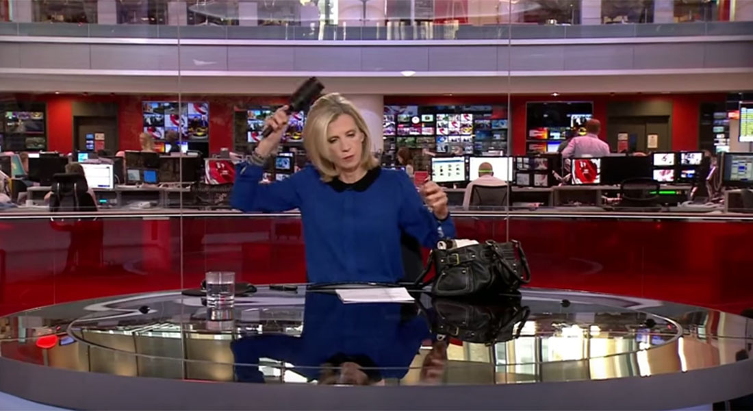 Carole Walker brushes hair on camera