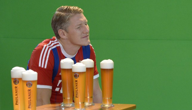 Bayern Munich's midfielder Bastian Schweinsteiger is pictured at the set of a beer advertising photo shoot of German first division Bundesliga football club FC Bayern Munich in Munich, southern Germany, on August 31, 2014. AFP PHOTO/CHRISTOF STACHE        (Photo credit should read CHRISTOF STACHE/AFP/Getty Images)