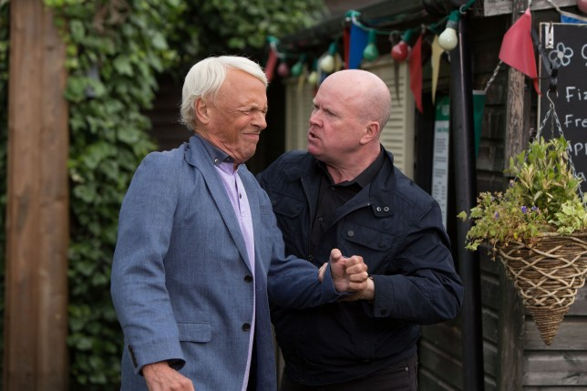 WARNING: Embargoed for publication until 01/09/2015 - Programme Name: EastEnders - TX: 11/09/2015 - Episode: 5136 (No. n/a) - Picture Shows: ***FORTNIGHTLIES PLEASE DO NOT USE (SOAP LIFE and ALL ABOUT SOAP) Phil tells Gavin they need to talk. Gavin Sullivan (PAUL NICHOLAS), Phil Mitchell (STEVE MCFADDEN) - (C) BBC - Photographer: Jack Barnes