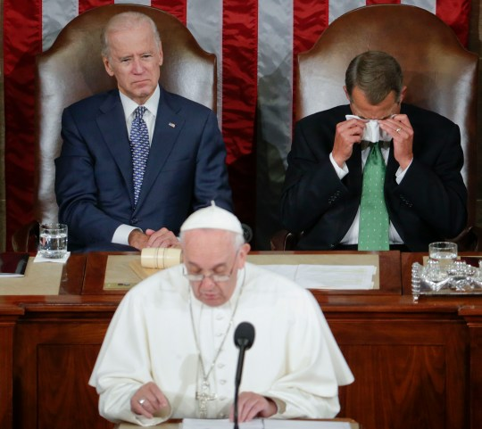 House Speaker John Boehner of Ohio wipes his eyes as he listens to Pope Francis address a joint meeting of Congress (Picture: AP)