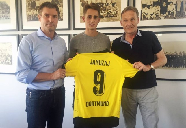 DORTMUND, GERMANY - AUGUST 31: Adnan Januzaj (C) signed his contract for a loan move from Manchester United to Borussia Dortmund and poses for a picture together with his new shirt, and with Michael Zorc (L, sports director of Borussia Dortmund) and Hans-Joachim Watzke (R, CEO of Borussia Dortmund ) on August 31, 2015 in Dortmund, Germany. (Photo by Alexandre Simoes/Borussia Dortmund/Getty Images)