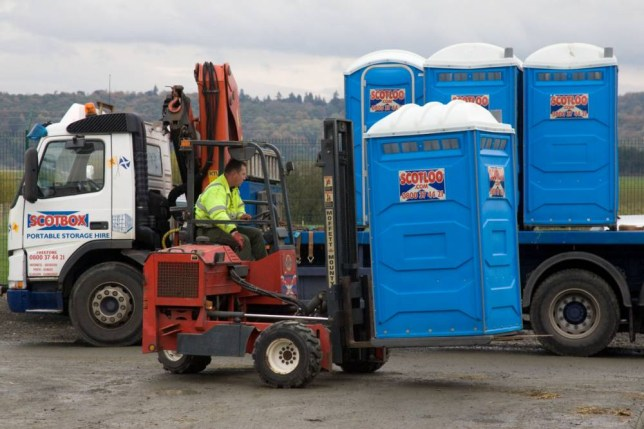 BFXBNC Forklift unloading portaloo from a lorry