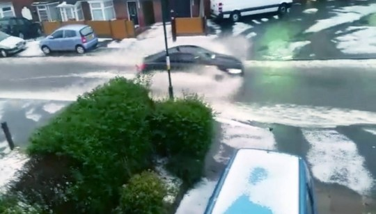 Hail, snow and rainfall of almost biblical proportions lead to torrents flowing down a street in Northfield, Birmingham on Tuesday evening, September 1, 2015. See NTI story NTISNOW. The adverse weather conditions lasted for about thirty minutes and was captured by Paul Rigby at 7.30pm.