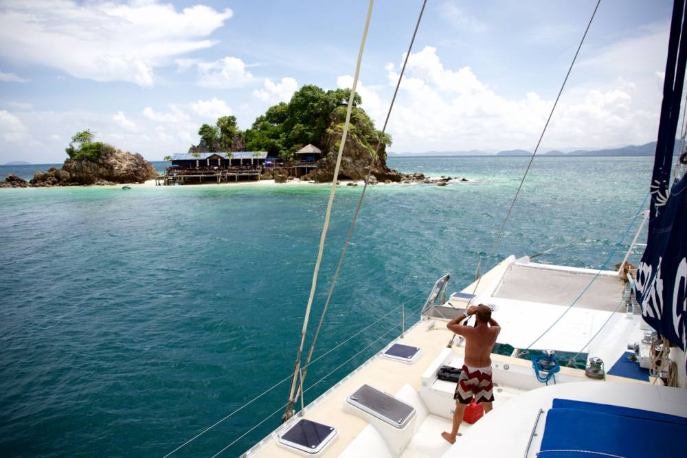 PIC BY COBOAT / CATERS NEWS - (PICTURED: Working in Thailand.) A company is of offering a group of digital nomads the chance to move their office to the high seas - sailing around the world while they work. The daily grind will become the SAIL-y grind, as passengers access high-speed internet and work on personal projects while looking out on glorious blue waves. The revolutionary idea, called Coboat, lets individuals share a work space aboard an 82-foot catamaran, which has space for 20 workers at any given time. Coboat, who are based in London, is set to sail from Thailand in November 2015, before circumnavigating the globe through a number of breath-taking locations. SEE CATERS COPY