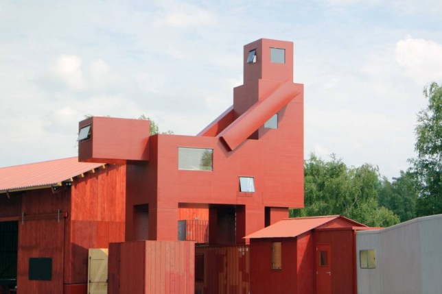 PIC FROM ATELIER VAN LIESHOUT / CATERS NEWS - PICTURED: The Domestikator.) A BONK-ERS building has been constructed in the shape of what appears to look like a couple having sex. The bizarre structure is a temporary installation which doubles as a hotel capsule for VIPs at the annual Ruhrtriennale Festival in Bochum, Germany. It has been named the Domestikator by Atelier Van Lieshout, the creative firm who erected the unusual building. They revealed their aim was to show the power of humanity over the natural world, and our disrupted relationship with nature. SEE CATERS COPY