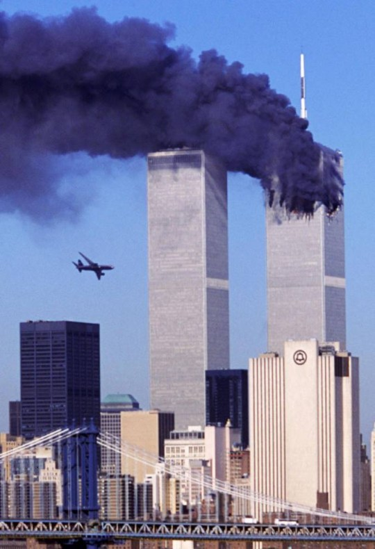 Hijacked United Airlines Flight 175, which departed from Boston en route for Los Angeles, is shown in a flight path for the South Tower of the World Trade Towers Sept, 11, 2001. The North Tower burns after American Airlines Flight 11 crashed into the tower at 8:45 a.m. (AP Photo/Aurora, Robert Clark)...A...NEW YORK...NY...USA